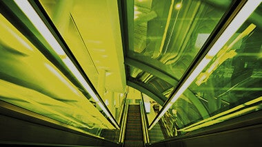Green underground escalator going up